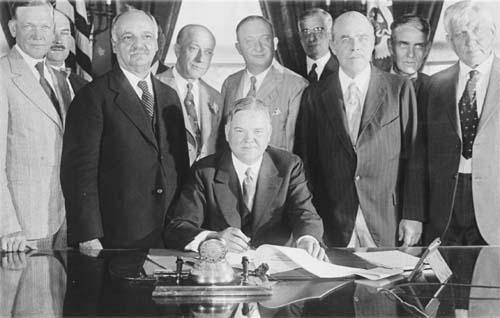 Hoover at desk