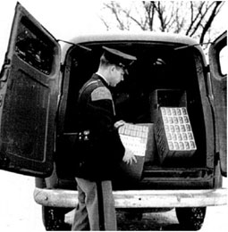 Graphic 5: Michigan State Police Inspecting Seized Cigarettes in 1951 - click to enlarge