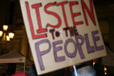 'Listen to the People' sign