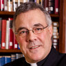 [Photo of Father Robert A. Sirico]