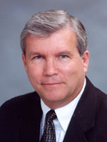 [Photo of Dr. Dave C. Aussicker]