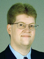 [Photo of Dr. Kirk A. Johnson]