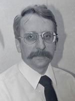 [Photo of Dr. John Semmens]