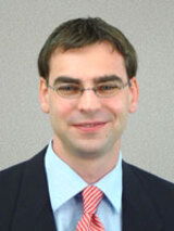 [Photo of Dr. Ryan S. Olson]