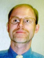 [Photo of Dr. Dirk C. Van Raemdonck]